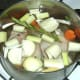 Water is added to duck legs and stock ingredients