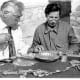 Archaeologist Viktor Sarianidi (left) and Terkesh Khodzhanyanov inspecting gold objects excavated from Tillya Tepe, Tomb IV, 1978 - © Viktor Saranidi, National Museum of Afghanistan / Musée Guimet