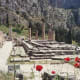 The foundations of the Temple of Apollo at Delphi, with ever-present poppies.