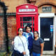 Near a big red phone booth