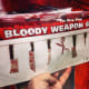 Bloody Weapon Garland is the perfect touch for your Halloween decor!