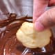 Dip the cooled butter cookies into the chocolate ganache for decoration.