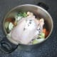 Whole chicken ready to be poached