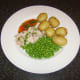 Sweet chilli sauce and coriander/cilantro garnish the poached chicken leg meal