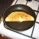 Omelette is carefully folded over