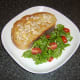 Chicken butter toast is plated with salad