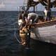 Sponge diver entering the water - 1945