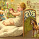 Vintage Christmas cards: Little child in bed with antique dolls