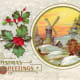 Free Victorian Christmas card with Dutch windmill in the snow with a holly border