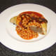A Forfar Bridie served with baked beans in tomato sauce and HP Sauce