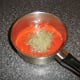 Preparing the tomato sauce for the fish pie
