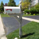 Use a pressure washer to strip off loose paint from a mailbox post