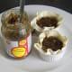 Mincemeat is carefully spooned in to pie casings in ramekins