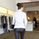 Kim Kardashian in leather pants and high heels rear view