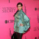 Kim Kardashian in tight pants and high heels at a Victoria Secret event