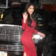 Kim Kardashian in curve hugging red dress and high heels