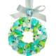 10. To complete the wreath I make a small bow that I attach with glue to the ribbon. For the pictured wreath I adhered two small cobbles to the bow, beads work well too. The ends of the ribbon were tied into an attractive knot for hanging. Beautiful!