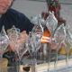 First Step: Fabricator Swirling Molten Glass within Mold Held at Constant Temperature by Propane Torch