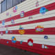 Florals on Red & White Striped Mural by Josue Ramirez at 2112 Leeland Street in Houston