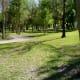 Shaded paths near children's playground in Archbishop Joseph A. Fiorenza Park