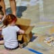 Children doing some chalk art at Creekfest