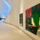 "The big painting shows ""Untitled (Krieg Böse)"", 1991 by Martin Kippenberger  (1953–97). The German artist expressed himself through different media and had a clear distinctiveness in his works. He was a leading artist in the 1980s."