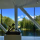 "Large panoramic windows open up to lots of natural light and beautiful views of nature and the trout river, Randselva. In the foreground is Pedro Reyes's sculpture ""Navaja Suiza VIII (Swiss Army Knife VIII)"", 2014."