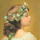 Little girl with Christmas holly crown