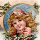 Little girl with Christmas holly crown and wrap