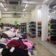 Inside the shop with carts of cheap clothes