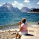 Using the boat ramp area as a seat while viewing the action at Jackson Lake in the Tetons.