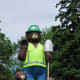 Smokey in a safety vest, celebrating 100 years of papermaking in International Falls