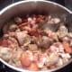 "Adding the ""chouriço"" and bacon"