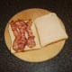 Bacon strips are laid on bread