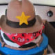 A delicious cake with a cowboy and badge made the theme even more playful.