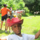 DeShawn, celebrates with his cowboy outfit after taking a horseback ride. This was a nice event for children and adults which was planned by his mother Darlena and some friends.