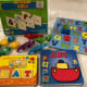 Alphabet puzzles, books, popbeads, alligators, and word activities