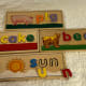 This is the Melissa & Doug See & Spell. Each board has a three-letter word on one side and a four-letter word on the other.