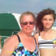 Grandmother and granddaughter enjoying beach time together.
