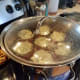 Step Nine: When it starts to boil rapidly, tilt the lid and turn the heat down a couple notches. Set the timer.