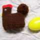 Used a worsted weight yarn for body in a solid color. (Plastic egg fits inside underneath.)