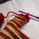 Start crocheting the comb from the back of the head.
