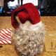 Position your old stocking or Santa hat on top of your container and secure it with hot glue.