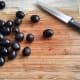 Slicing the olives.