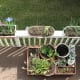 A bird's eye view of our first floor balcony, where we have a total of 4 rail planters, plus our movable planter platform.
