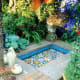 colorful Italian mosiacs inspired by Spanish and Moroccan courtyards make a water feature that is soothing and cheerful