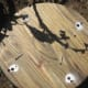 Once the stakes are in the ground lay the board on top readying for the screws.