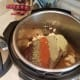 Add in your garlic, spreading it evenly throughout the pot.