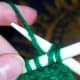 Yarn over the working needle.