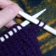First, knit two stitches onto the working needle.